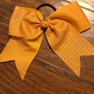 Yellow sparkle cheerleading bow